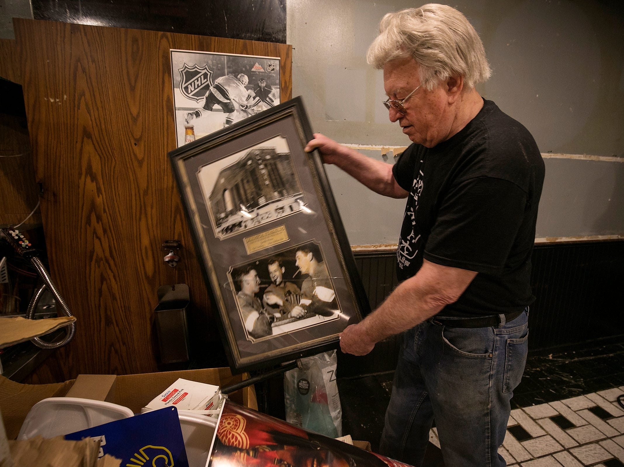 Cobo Joe's co-owner Richard Cadreau, 71, packs up memorabilia before closing the doors of the Detroit sports bar on Tuesday, July 31, 2018.