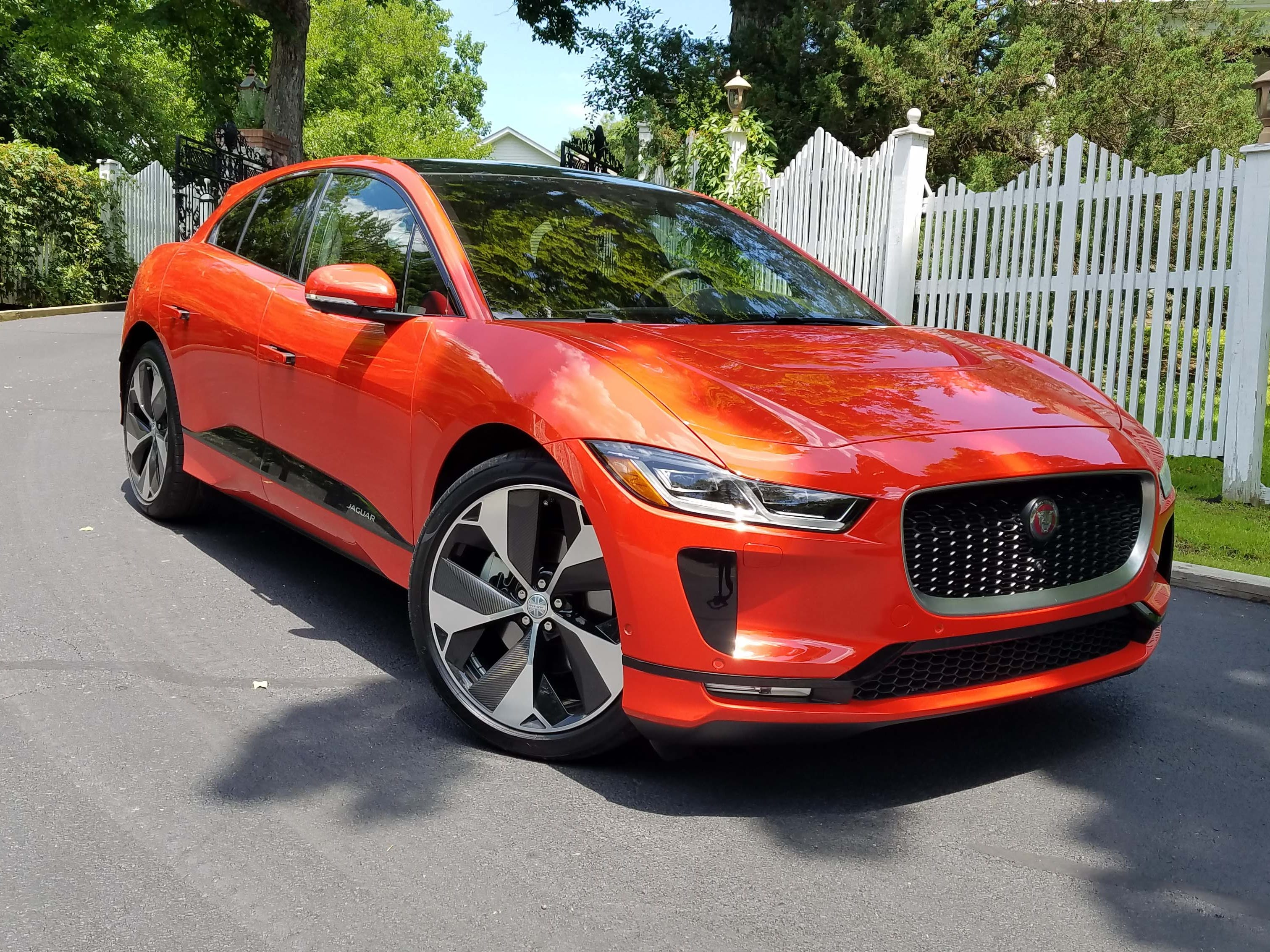 The Jaguar I-Pace bears familiar brand touches like angled headlights and open grille. A low roof line and deeply-scalloped rocker panels also give the exterior a unique character.