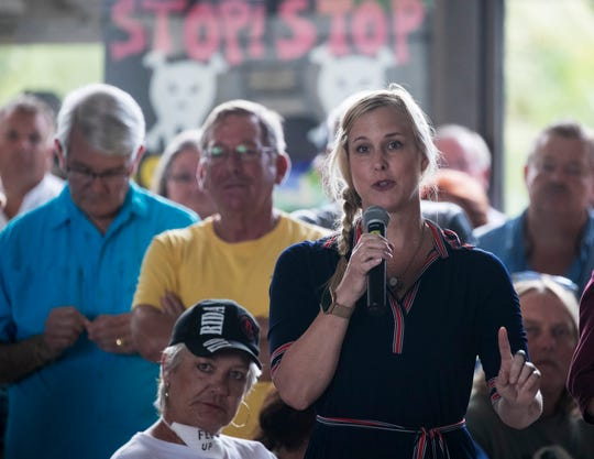 Kristina Jackson of Cape Coral asks a question at the meeting with the U.S. Army Corps of Engineers on Tuesday at the Cape Coral Yacht Club.