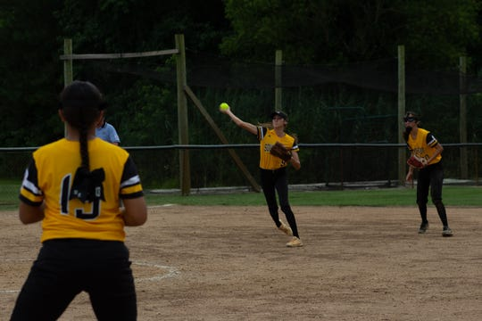 Southeast's Audrey Mills throws out at a runner at first base. The Southeast Senior Little League softball team from Florida District 9 dropped a close game to Central out of Fort Wayne, Indiana, 5-4 on Tuesday afternoon in Roxana, Delaware.