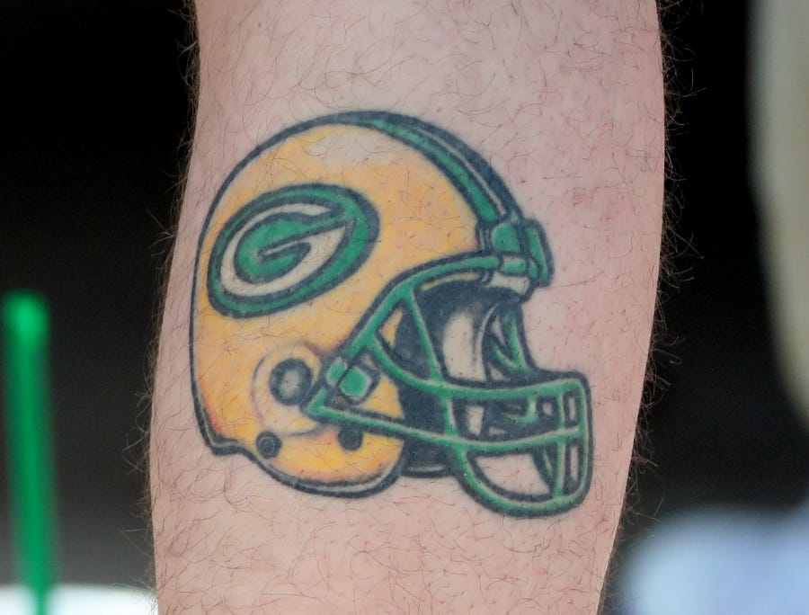 A fan sports a calf tattoo during Green Bay Packers Training Camp Tuesday, July 31, 2018 at Ray Nitschke Field in Ashwaubenon, Wis