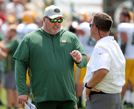 Head coach Mike McCarthy talks with general manager Brian Gutekunst during Green Bay Packers Training Camp Tuesday, July 31, 2018 at Ray Nitschke Field in Ashwaubenon, Wis.
