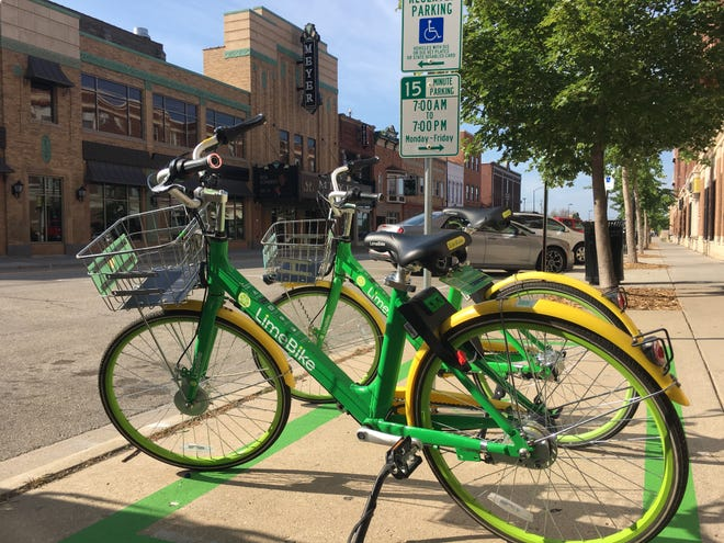 LimeBike rolled out its bike share program in Green Bay on July 30. The bicycles, seen here by the Meyer Theatre, can be rented by the half-hour via the Lime app.