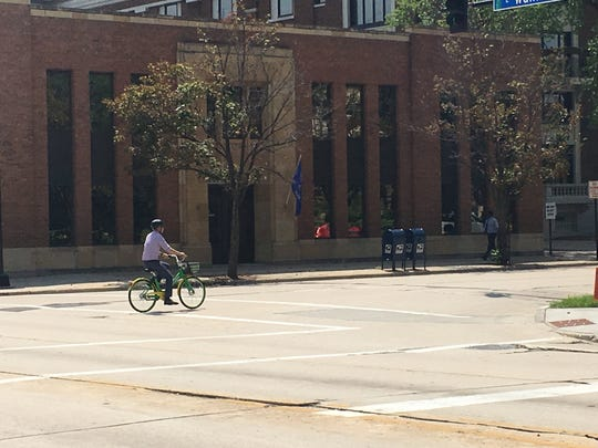 A user rides a Limebike south on Jefferson Street Tuesday morning.