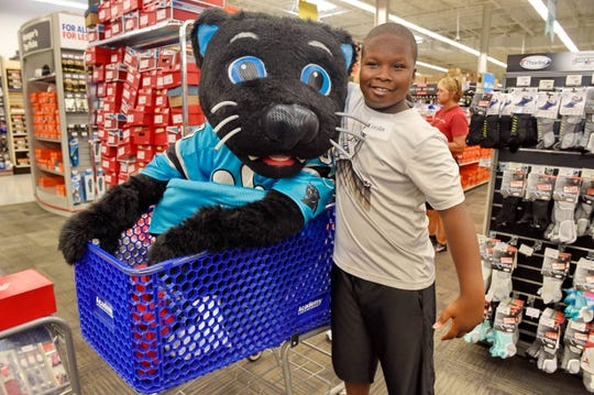 The Carolina Panthers' Thomas Davis and Academy Sports + Outdoors held a back-to-school shopping spree for 25 local kids Tuesday, July 31, 2018.