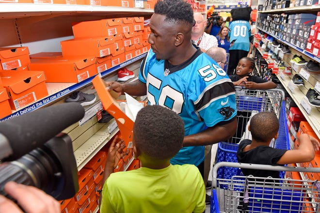 Thomas Davis helps 10 year old Messiah Robinson shop for shoes.The Carolina Panthers' Thomas Davis and Academy Sports + Outdoors held a back-to-school shopping spree for 25 local kids Tuesday, July 31, 2018.