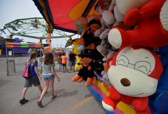 The Mighty Thomas Carnival midway at the Montana State Fair, Tuesday.