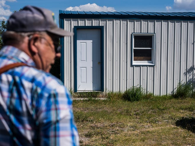 Bob Snodgrass stands near his family's original homestead shack on his 101-year-old farm in Pendroy.