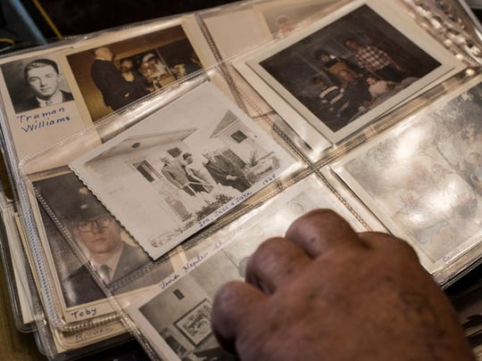 Bob Snodgrass flips through photo albums showing his family's long history in Montana.
