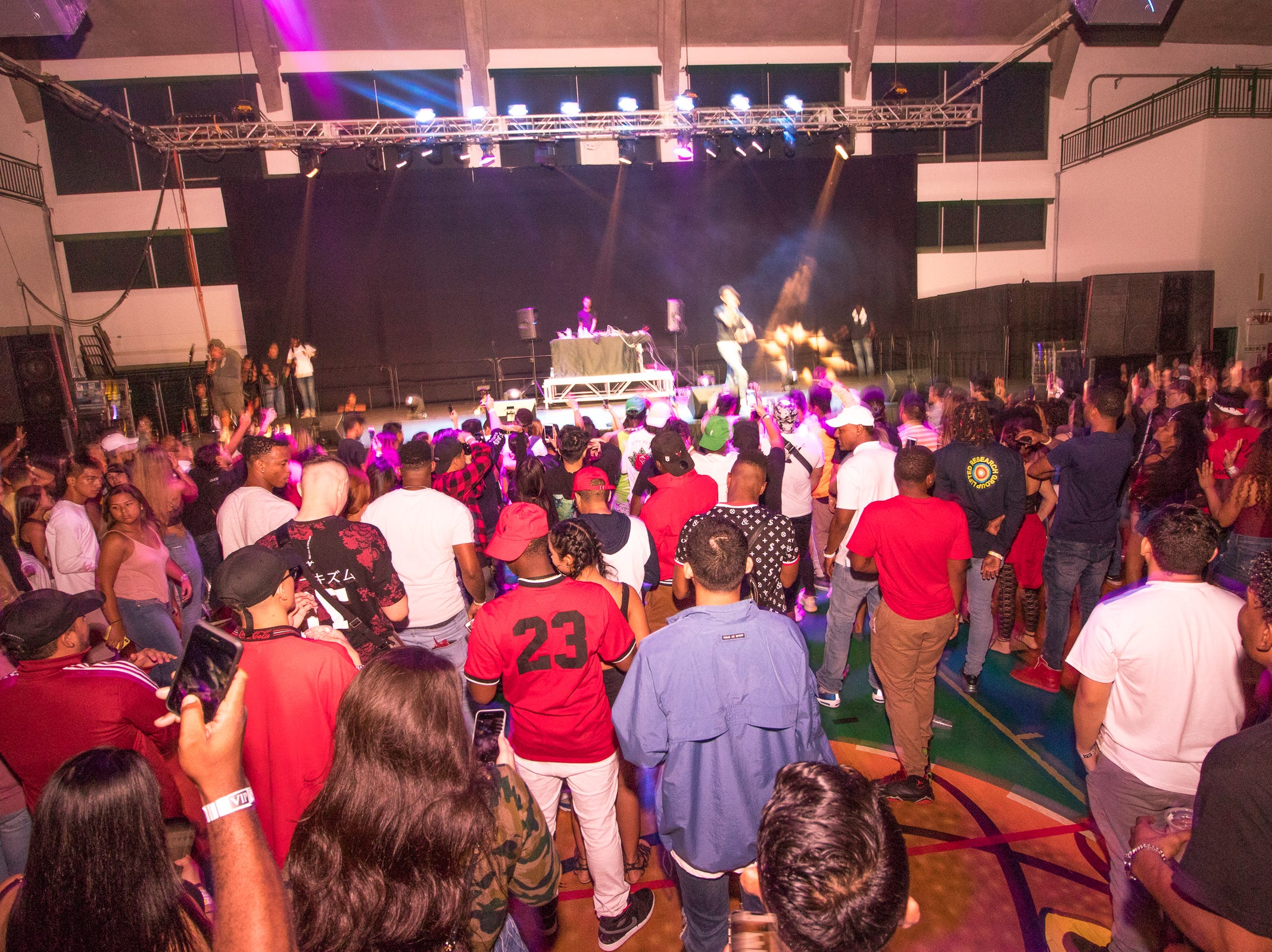 Fans cheer and sing along with PnB Rock at the University of Guam Calvo Fieldhouse on July 29.