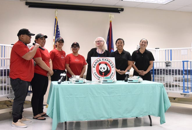 Representatives from Panda Express present $55,000 worth of cribs and other equipment to Guam Memorial Hospital for its pediatrics and neonatal intensive care units on July 31, 2018. Money customers dropped in donation boxes at the Panda Express restaurants on Guam was used toward the purchase, according to company representatives.