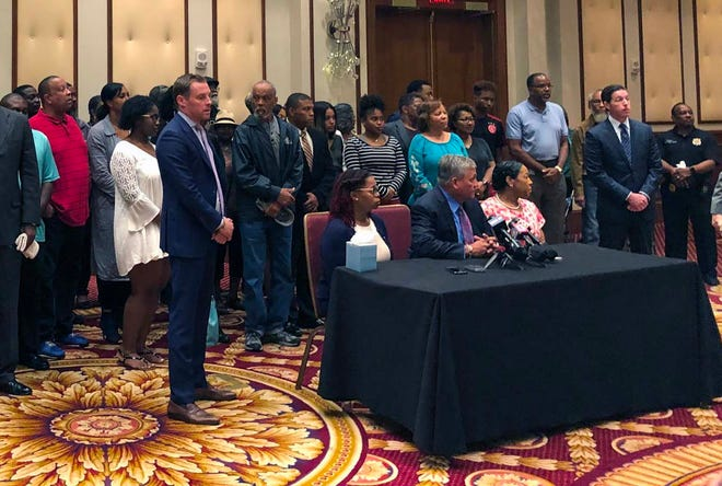 """Coleman family members and their lawyers discuss the family's loss at the Conrad Hotel in Indianapolis, on Tuesday, July 31, 2018. """"We lost a branch of our family tree,"""" says one family member. """"We lost friends,"""" says another."""