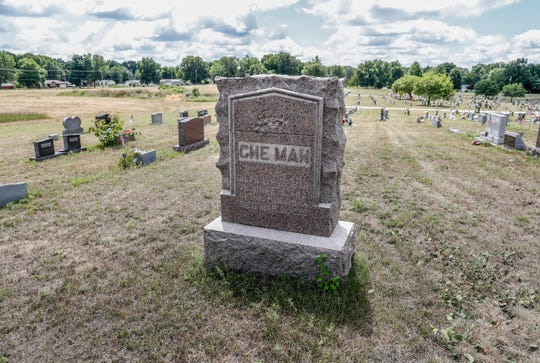 "The grave of Che-Mah the ""Chinese Dwarf,"" 1838-1926, sits atop a crown at Crown Hill Cemetery in Knox Ind., on Tuesday, July 24, 2018. Che-Mah, who retired to Knox Ind. from his successful career touring internationally as the smallest man in the world, measuring 28 inches tall and weighing 40 pounds died at the age of 87."