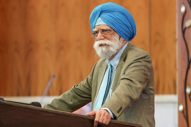 KP Singh, from Sikh Satsang of Indianapolis, speaks at a solidarity gathering for Congregation Shaarey Tefilla in Carmel, Ind., Monday, July 30, 2018, after anti-Semitic vandalism was left there over the weekend.
