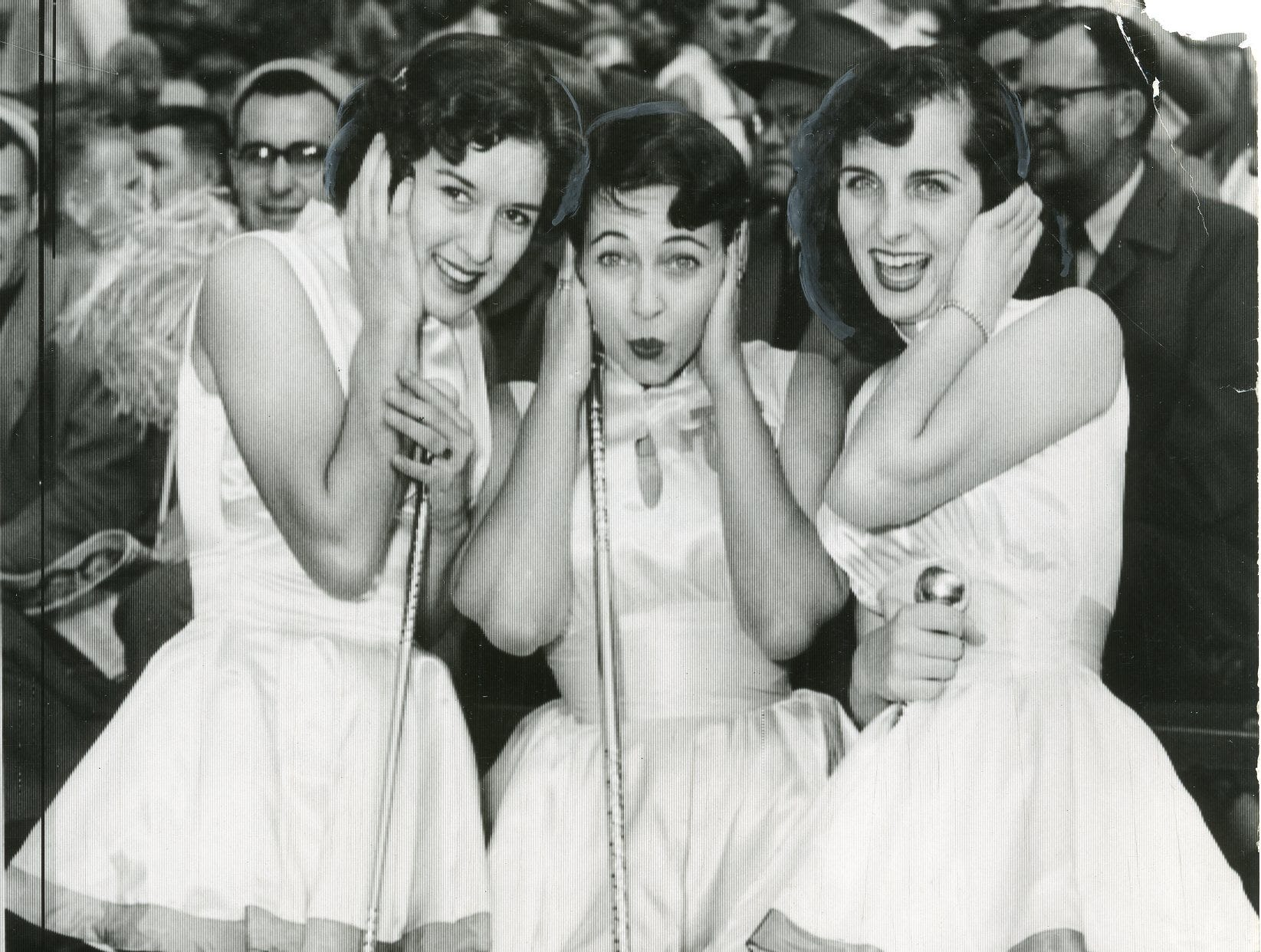 UT majorettes Anne Dale Guinn, Mary Lee Thomas and Anne Thompson are chilly during a November, 1954 game.