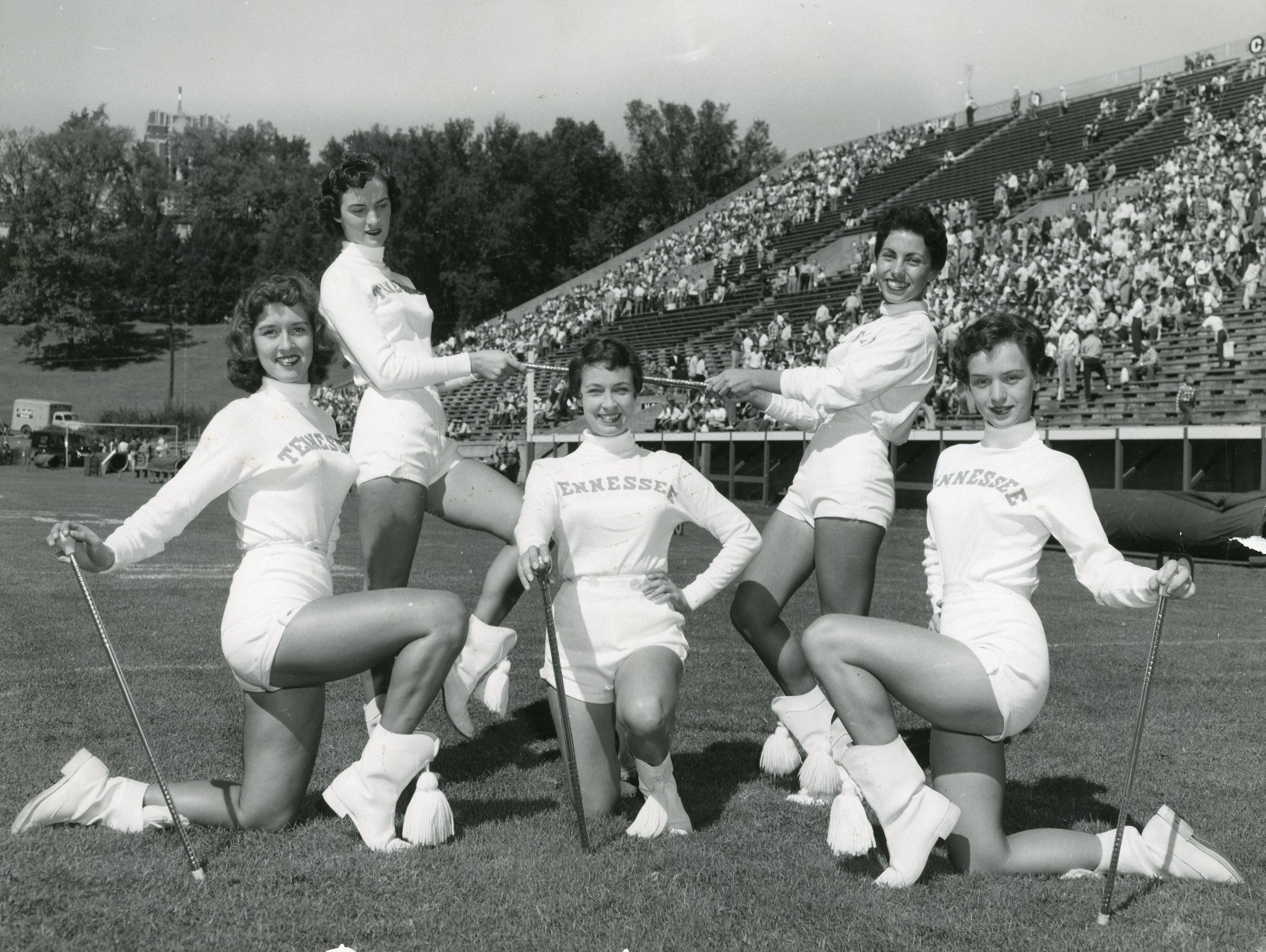 The 1955 UT majorettes included (front) Ann Dale Guinn, Mary Thomas, Lucy Hatmaker; (back) Carolyn Johnson and Sadie Harder.