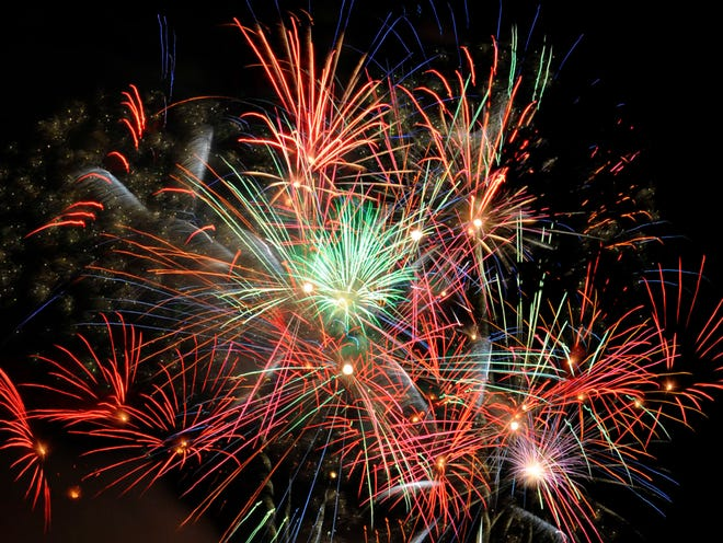 Fireworks explode over the Henley Bridge during Boomsday celebrations in Knoxville on Saturday, Aug. 30, 2014.