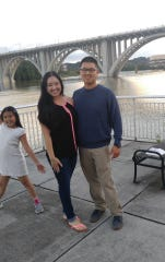 Alice Tran, middle, poses with her brother, Stan Tran, right, and her sister, Heaven Phan. Alice Tran was on vacation with her sister and brother when she was nearly struck by lightning near Charleston, South Carolina, in early July.
