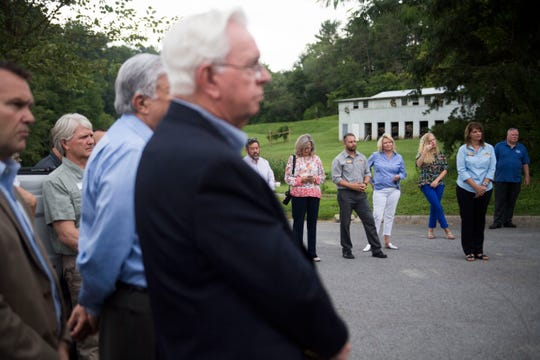 Attendees of a groundbreaking for Watson Glades, a new affordable housing complex, listen in Sevier County Tuesday, July 31, 2018.The Tennessee Housing Development Agency and Citizens National Bank are helping fund the project.