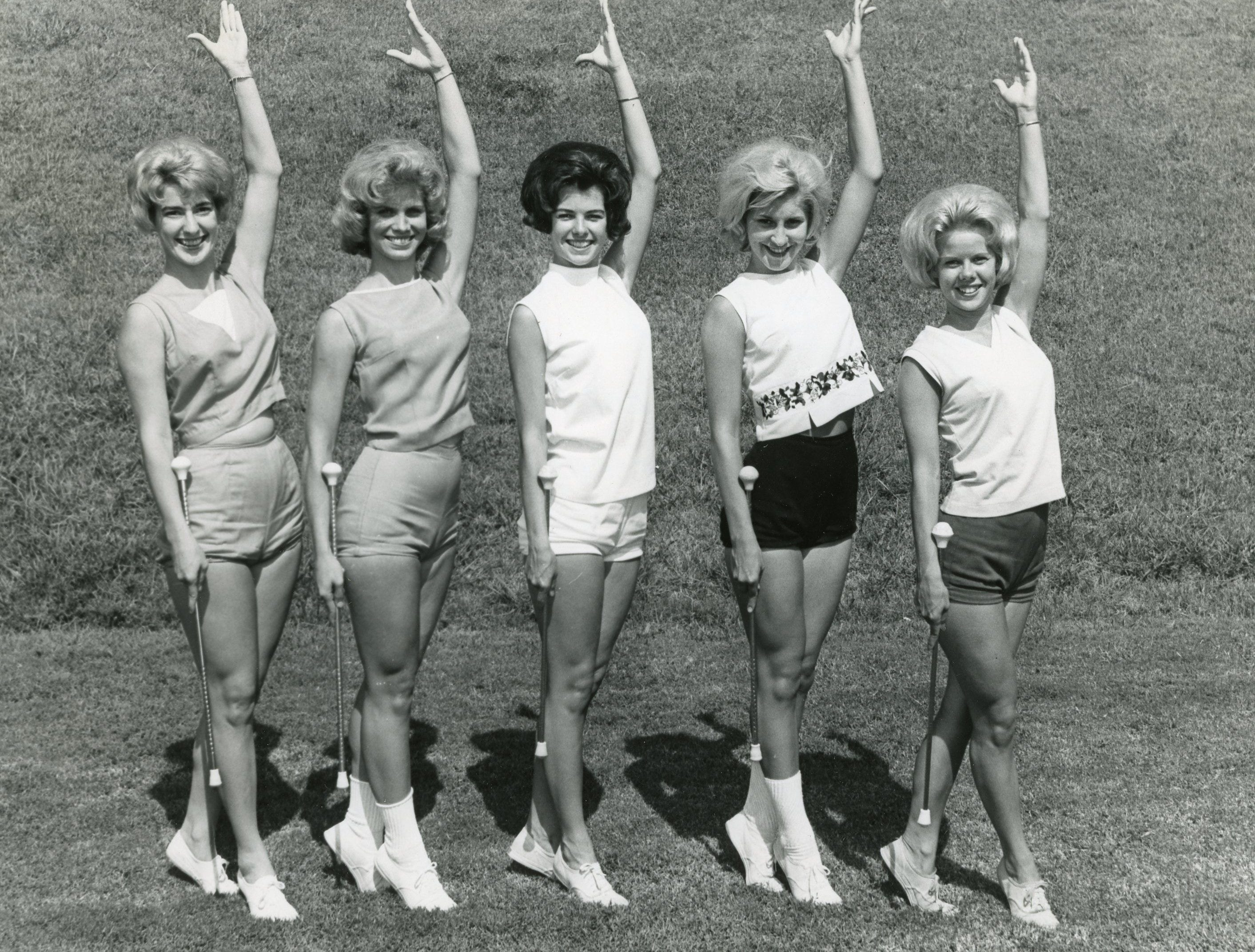 These five UT majorettes twirled for South High School. Pictured are Brenda Flowers, Judy Barton, Bette Carlson, Brenda Murrell and Mary Nicholon. September, 1963.