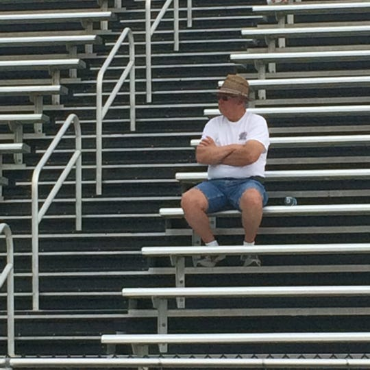 Rick Stansberry watches his grandson Carson Cole and the rest of the Powell High School football players during a recent practice.