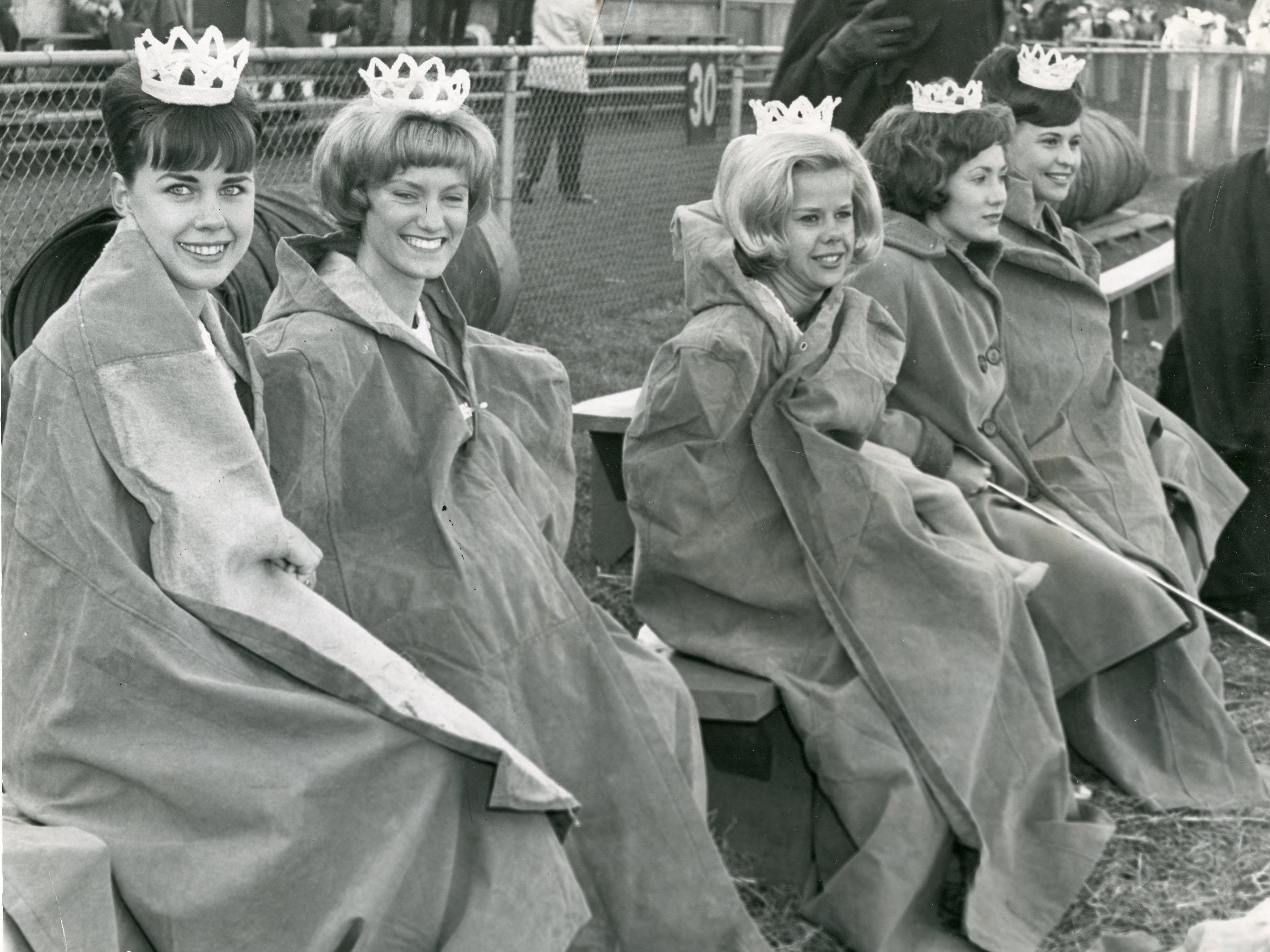 UT majorettes try to keep warm during a November, 1964 game. Pictured are Patti Stuart, Melinda Hewgley, Mary Nicholon, Valerie Foster and Elaine White.