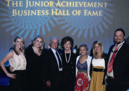 Phillips with family members at the 2010 Junior Achievement Business Hall of Fame awards.