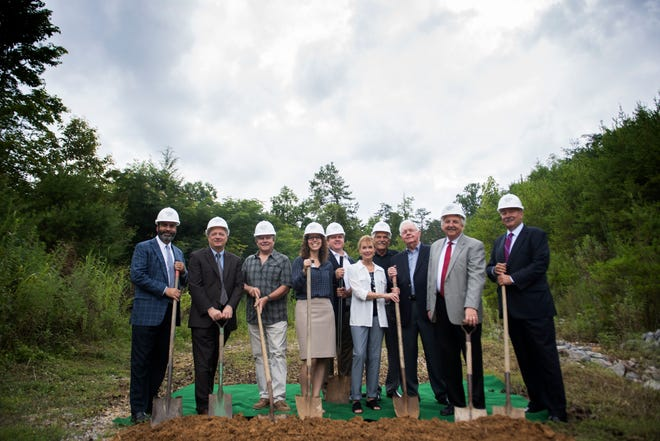 Officials gather for a photo at a groundbreaking ceremony for Watson Glades, a new affordable housing complex in Sevier County on Tuesday, July 31, 2018. The Tennessee Housing Development Agency and Citizens National Bank are helping fund the project.