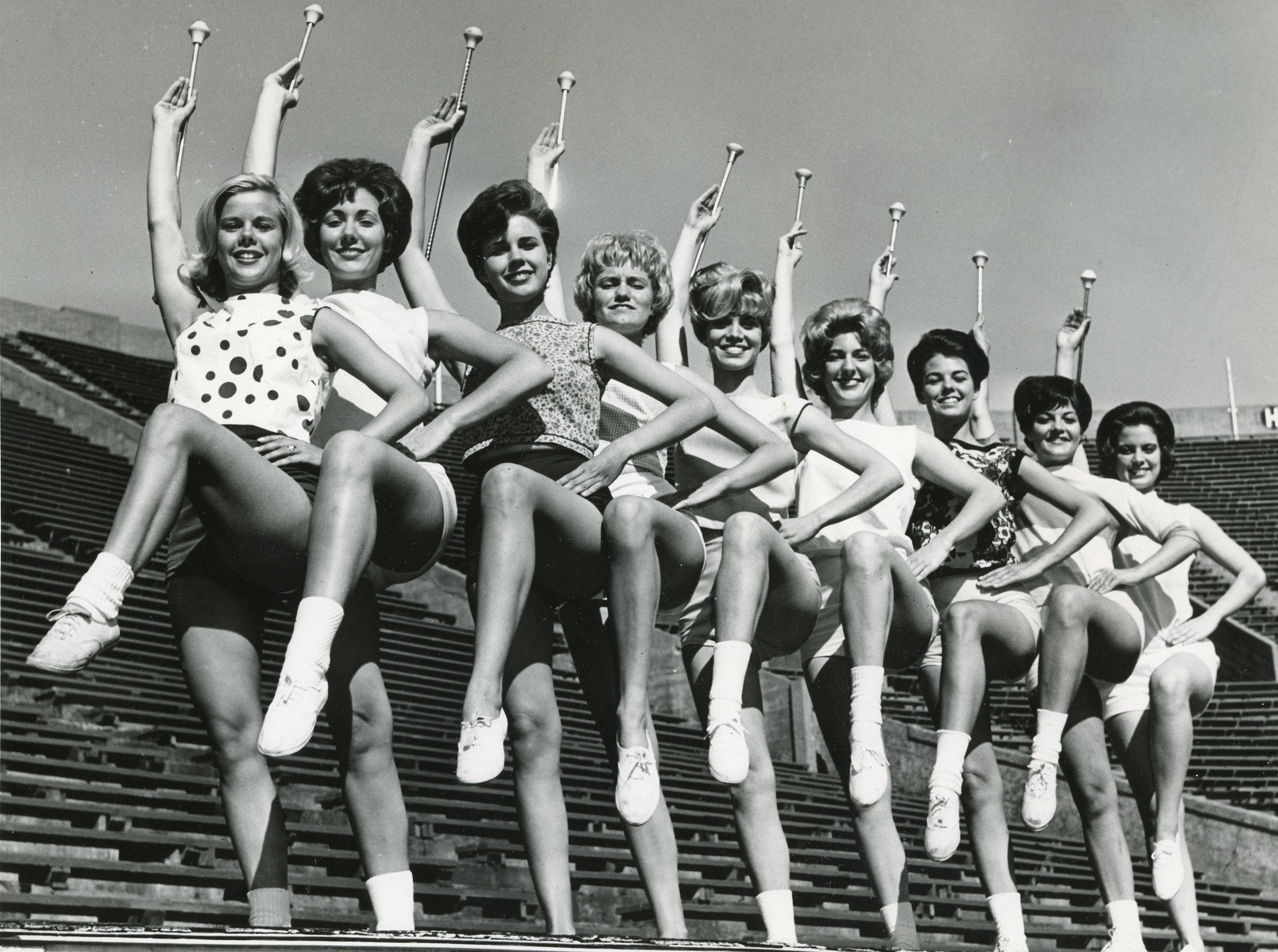 Kicking high for ol' UT were the 1964 majorettes: Mary Nicholon, Valerie Foster, Patti Sue Stuart, Melinda Hewgley, Judy Barton, Brenda Flowers, Bette Carlson, Betty Sue Little and Judy Phillips.