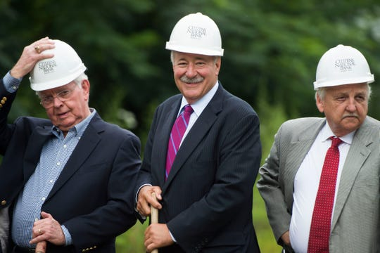 From left, Bill Kilpatrick, chairman of the board for Citizens National Bank, David Verble, president and CEO of Citizens National Bank, and Sevier County Mayor Larry Waters stand at a groundbreaking for Watson Glades, a new affordable housing complex in Sevier County Tuesday, July 31, 2018. The Tennessee Housing Development Agency and Citizens National Bank are helping fund the project.
