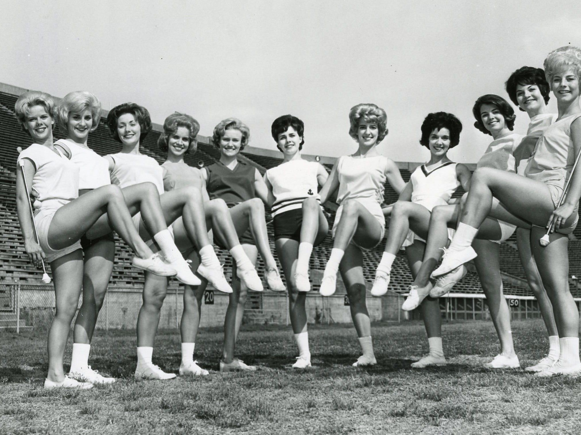 "UT ""High Steppers"" for the 1963/64 season included from left: Mary Nicholon, Brenda Murrell, Valerie Foster, Judy Barton, Melinda Hewgley, Patti Stuart, Brenda Flowers, Marcia Austin, Bette Carlson, Betty Sue Little and DeAnna Smith."