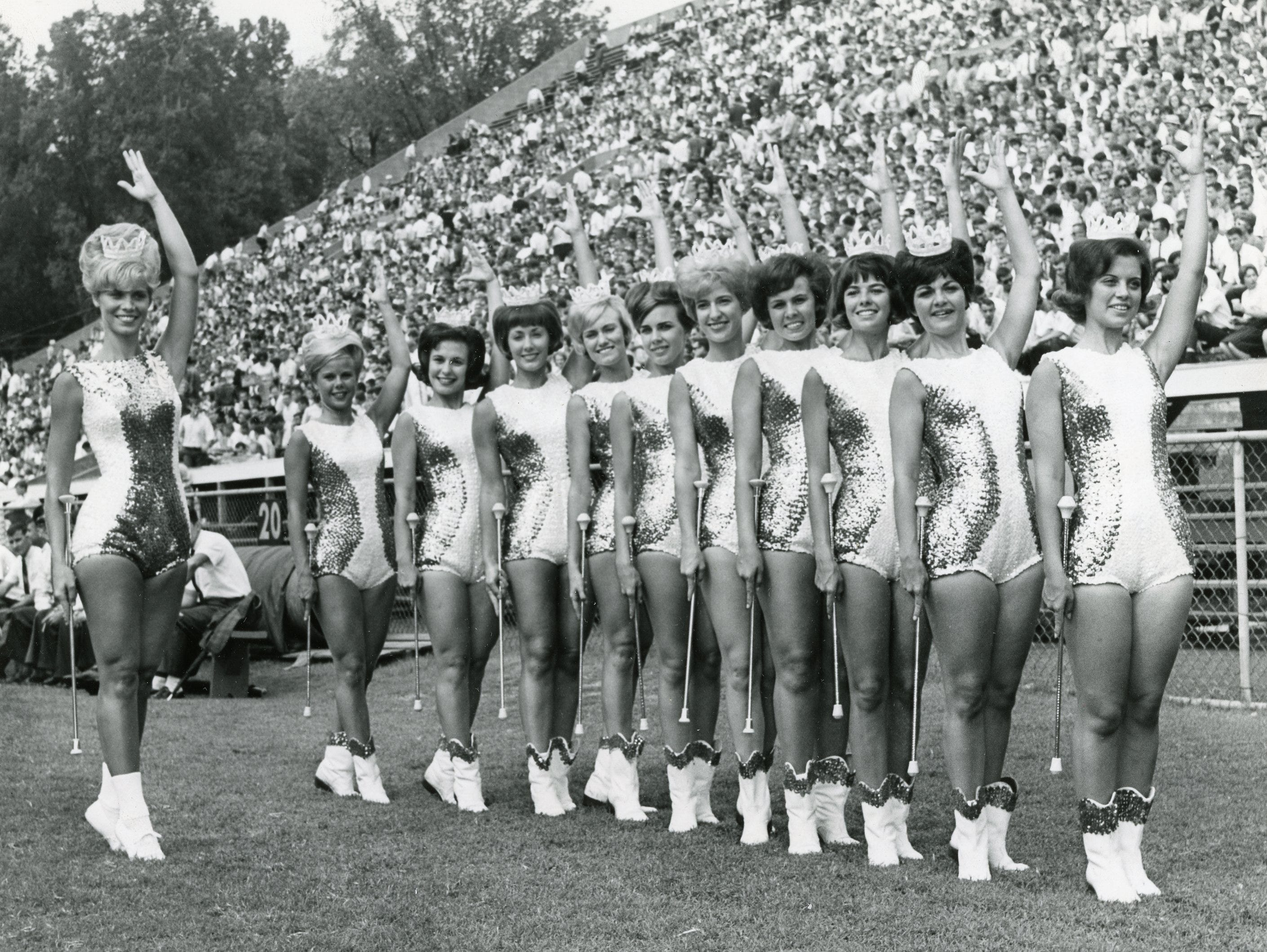 UT majorettes on the field before the UT/Chattanooga game, September, 1964. Pictured are (from left): head majorette Judy Barton, Mary Nicholon, Elaine White, Valerie Foster, Melinda Hewgley, Patti Stuart, Brenda Flowers, Deede Wiggins, Betty Carlson, Betty Sue Little and Judy Phillilps.