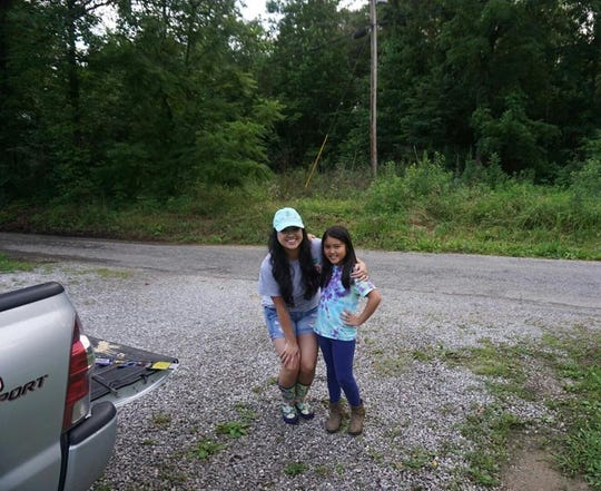 Alice Tran, left, poses with her younger sister Heaven Phan. Phan helped save Tran by calling 911 after her near-death accident near Charleston, South Carolina, in early July.