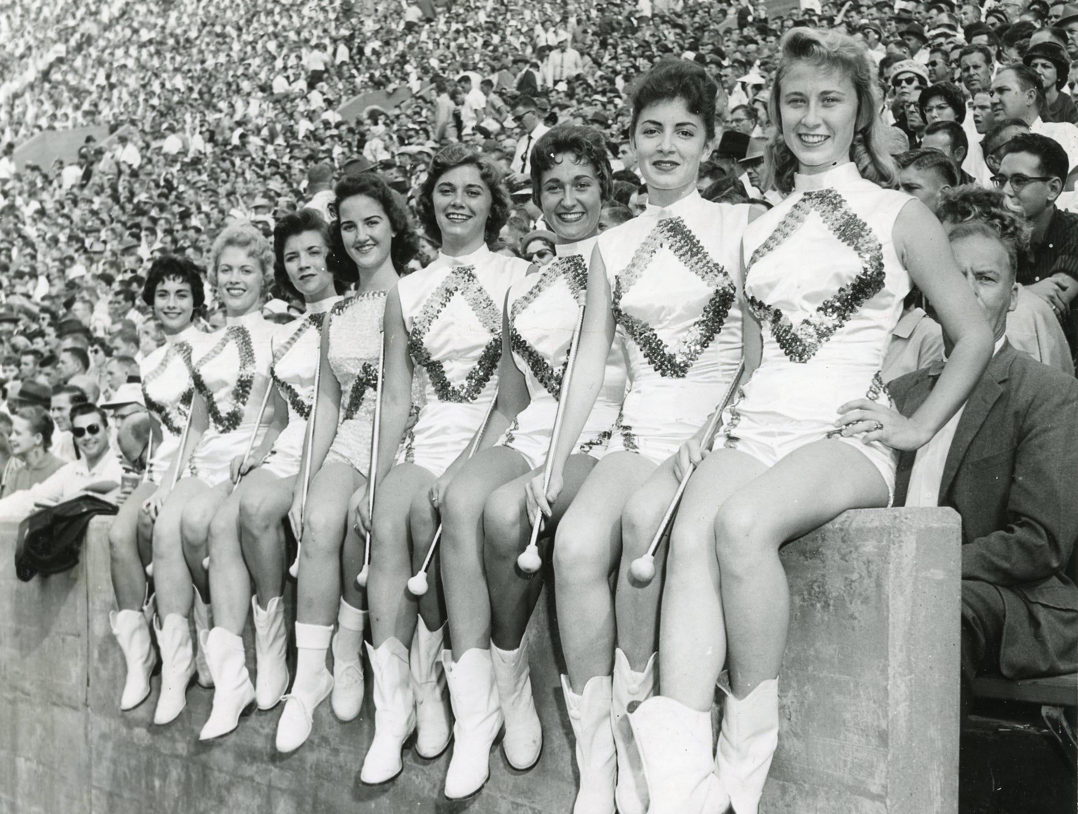 UT majorettes (from left) Brenda Jo Smith, Helen Newport, Mary Ruth DeArmond, Claudette Riley, Celia Wright, Phyllis Swann, Lyna Free and Jo Hawk. October, 1959.