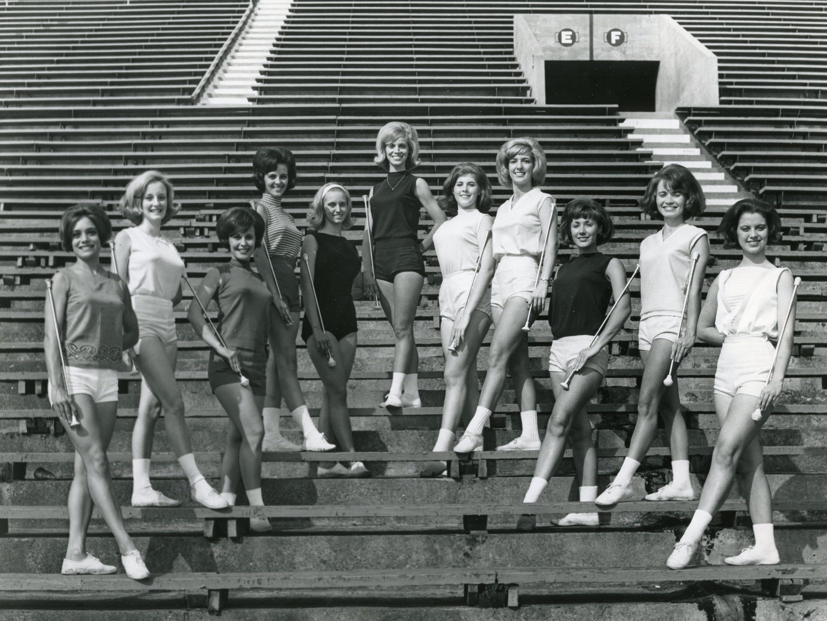 The 1965/1966 UT majorettes: Becky Nanney, Diane Fleming, Elaine White, Katherine Price, Pam Bailey, Judy Barton, Betty Lou Simpson, Brenda Flowers, Valerie Foster, Mary Kay Bettis and Judy Phillips.