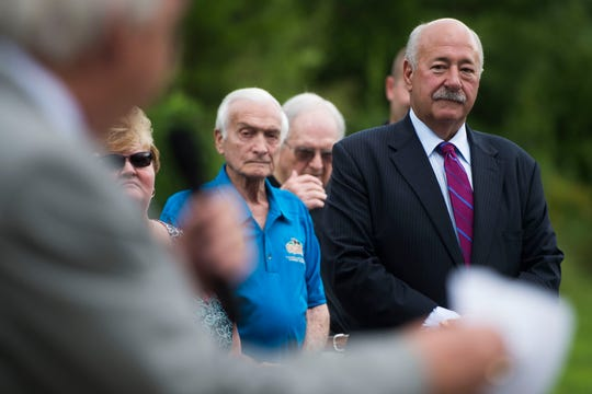 At right David Verble, president and C.E.O. of Citizens National Bank listens to Larry Waters,