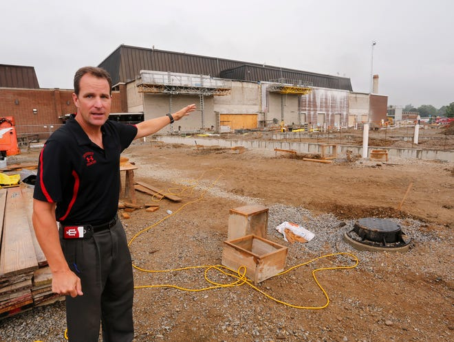 Lafayette Jeff Principal Mark Preston points out the area where a new pool is being constructed Tuesday, July 30, 2018, in Lafayette. The new pool, slated to be completed by January 2020, is being constructed just east of the Crawley Center. The old pool will be converted into a weight room.