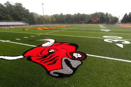 A new turf football field is in the process of being installed at McCutcheon High School Tuesday, July 30, 2018, in Lafayette. Fellow county school Harrison High School is also receiving a new turf field for football.