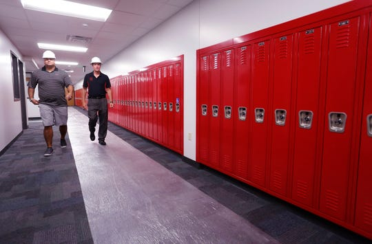 Tecumseh Junior High School principal Brandon Hawkins, left, and Lafayette Jeff principal Mark Preston walk past new lockers in the special education suite Tuesday, July 30, 2018, at Tecumseh. The special education suite also features a walk out patio. New additions to the performing arts are also taking place at Tecumseh. All are slated to be ready when classes resume next week.