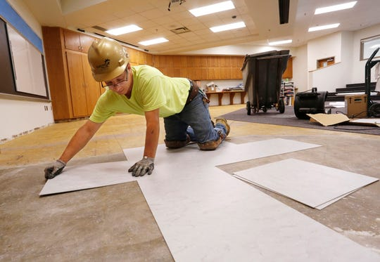 Dickie Gibbs measures the layout for new flooring in the innovation station Tuesday, July 30, 2018, at Cumberland Elementary School in West Lafayette. Extensive renovation work is taking place at Cumberland, but will be complete by the time classes resume next week.