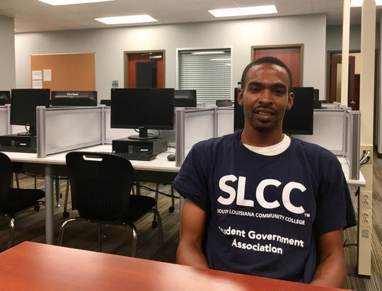 Eric Fontenot, 32, spends time in South Louisiana Community College's Center for Minority Excellence getting his schedule set, tutoring and other support.