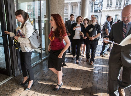 Occupy ICE protesters Sonja Devries and David Horvath, in rear, enter the Hall of Justice to be arraigned  on charges stemming from the demonstration at the Heyburn Building. July 31, 2018.