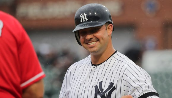 Former New York Yankee Nick Swisher is happy to be on third. 344a4d5be854