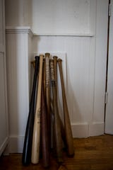 Old Louisville Sluggers found by Richard Sullivan in his painting studio in the Portland neighborhood of Louisville on Friday, July 27, 2018.