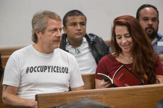 Protesters Robert Eiden and Sonja Devries wait to be arraigned for their participation in last week's demonstration at the Heyburn Building, where the ICE office is located. July 31, 2018.