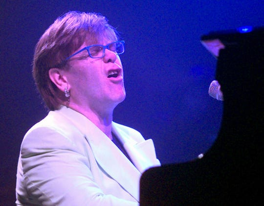 Elton John sang last night during his Freedom Hall concert.