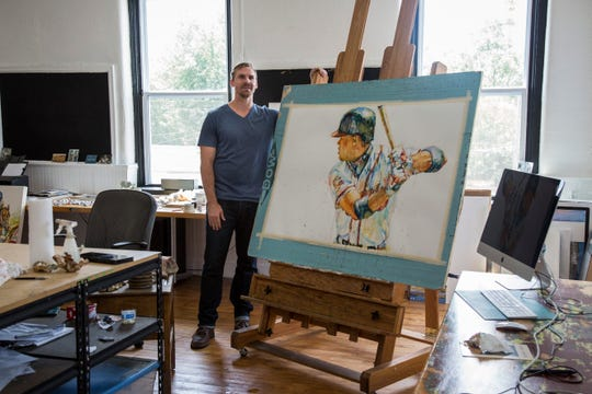 Richard Sullivan stands for a portrait next to his watercolor painting of Chipper Jones in his painting studio in the Portland neighborhood of Louisville on Friday, July 27, 2018.