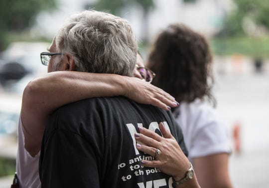 Occupy ICE protester David Horvath was hugged outside the Hall of Justice prior to being arraigned in connection to last week's demonstration at the Heyburn Building. July 31, 2018.