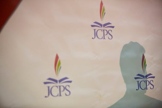 JCPS Superintendant Marty Pollio's shadow as he speaks at the 15th District PTA Clothing Asssistance Program inside Central High School Football Stadium on Tuesday, July 31, 2018.