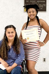 Graduate Tamara Outlaw, right, and her mother Shylah pictured after Tamara's GED graduation ceremony on Wednesday, July 25, 2018, at the downtown branch of the Capital Area District Libraries in Lansing.